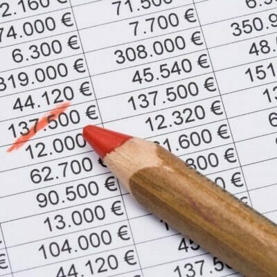 Setting,The,Red,Pencil,On,A,Financial,Planning,Sheet,(euro